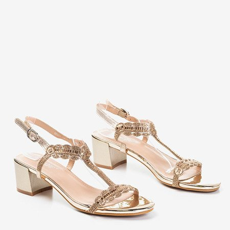 Golden sandals on a low post with cubic zirconia Doremies - Footwear